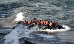 Refugees and migrants arrive on a dinghy on the Greek island of Lesbos, on October 30, 2015, after crossing the Aegean sea from Turkey. At least 17 children drowned when three boats sank en route from Turkey to Greece, officials said Friday, the latest tragedy to strike migrants braving wintry seas to seek asylum in Europe. Nine adults also lost their lives when the boats went down, with the drownings once again highlighting the human cost as Europe struggles with its worst migrant crisis since World War II. AFP PHOTO / ARIS MESSINISARIS MESSINIS/AFP/Getty Images