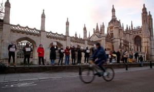 People attend a vigil for Sarah Everard at King's Parade street in Cambridge.