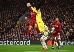 Poor communication means Liverpool goaltender Alisson and defender Fabinho go for the same ball.