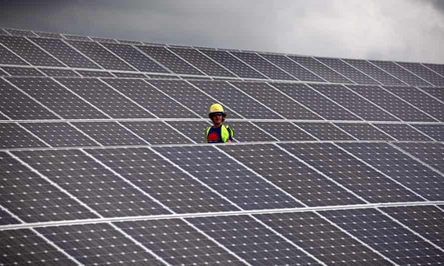 Lines of solar panels at a solar farm near Truro in Cornwall