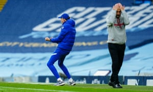 Chelsea manager Thomas Tuchel celebrates the winning goal scored by Marcos Alonso of Chelsea as Manchester City Manager Pep Guardiola reacts in despair.