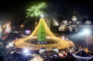 Crowds celebrate around a Christmas tree in Kiev, Ukraine