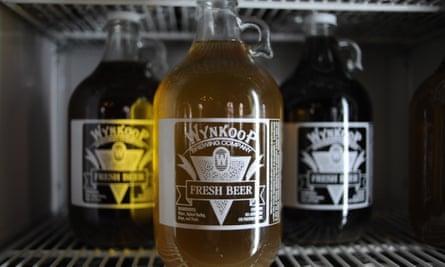 Growlers of Wynkoop Brewing Company beers sit in a cooler. Denver, Colorado.