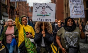Demonstrators march through Liverpool city centre during an anti lockdown protest on November 14.