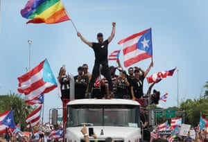 San Juan, Puerto RicoSinger Ricky Martin waves a flag as he joins with thousands of other people as they fill the Expreso Las Américas highway calling for the ouster of Gov. Ricardo A. Rosselló.