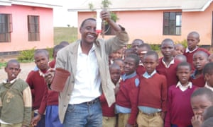 Dr Askwar Hilonga in a Tanzanian primary school demonstrating his water-filter