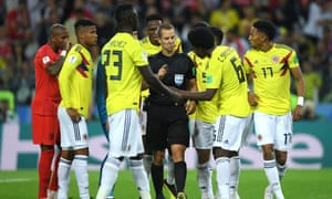 Colombia players confront referee Mark Geiger after he awarded England a penalty on Tuesday in a game that contained moments of play-acting from players on both sides.