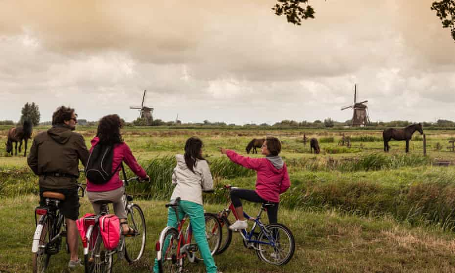 Family with two children on bikes,  Amsterdam