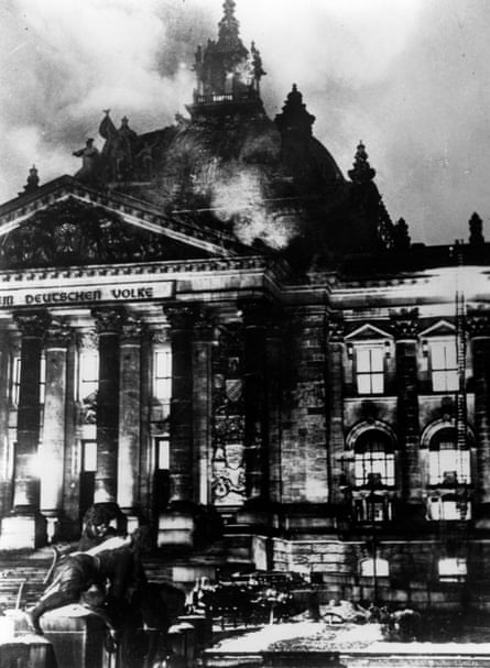 The Reichstag in flames during the Nazi ascent to power in Berlin, 1933.