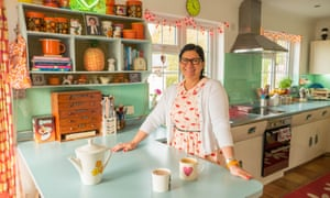 Diane Naested in the kitchen, with its retro Formica surfaces and 1950s English Rose cabinets