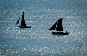 Restored cobles set sail in Bridlington, England. The coble is a traditional open fishing boat, and was once a familiar sight off the north-east coast. Due to the enthusiasm and dedication of owners, a number of cobles have been completely restored