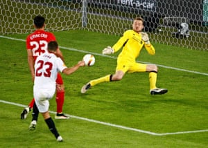 Sevilla's Coke fires the ball past past Liverpool's Simon Mignolet to score his second and Sevilla's third.