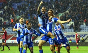 Dan Burn and Wigan celebrate the second goal of their shock win over Bournemouth.