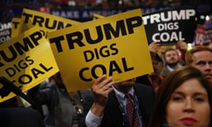 Republican national convention delegates hold signs reading 'Trump digs coal' in 2016