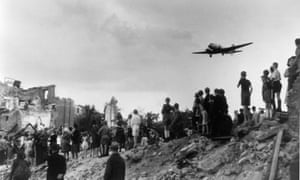 Berlin citizens watching the landing of an airlift aeroplane at Tempelhof airport during the blockade.