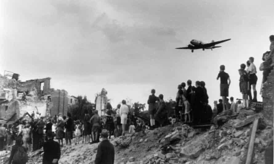 Berlin citizens watching the landing of an airlift aeroplane at Tempelhof airport during the blockade.
