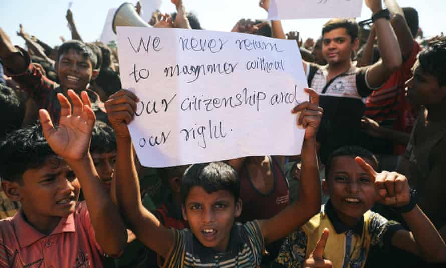A boy holds a placard as hundreds of Rohingya refugees protest against their repatriation at the Unchiprang camp in Teknaf, Bangladesh.