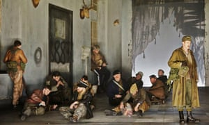 A scene from the Welsh National Opera's 2014 production of Macbeth with performers in early-20th century attire.