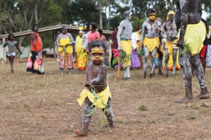 Young Joban Yunupingu, the great grandson of Gumatj leader Galarrwuy Yunupingu, leads the dancers towards the bunggul ground at the Garma festival.