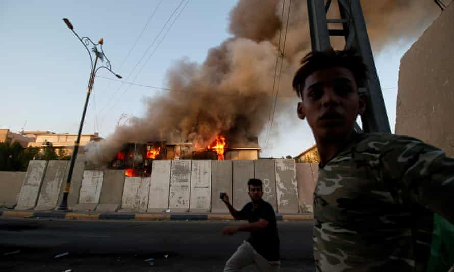 Smoke rises from the Basra provincial council building