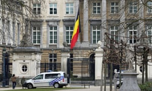 The Belgian flag hanging half mast at the Palais de la Nation, near the Maelbeek metro station in Brussels