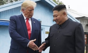 Kim Jong-un and Donald Trump prepare to shake hands at the border village of Panmunjom earlier this year.