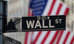 The Wall Street sign is pictured at the New York Stock exchange (NYSE) in the Manhattan borough of New York.