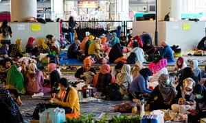 Domestic workers gather on a day off before the new restrictions.