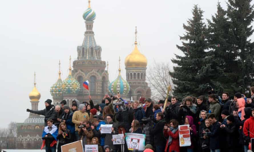 Opposition supporters rally Saint Petersburg on Sunday.