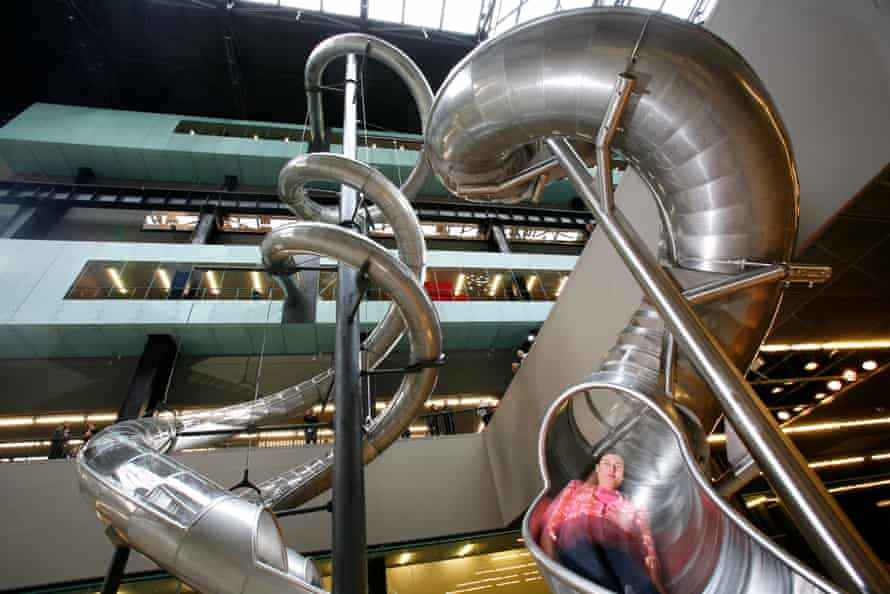 A visitor rides Test Site, Carsten Höller's slide installation in the Turbine Hall at Tate Modern.