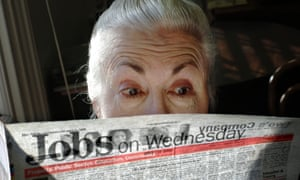 A surprised looking woman pensioner surveys the jobs on offer in her local paper.<br>A0JCYN A surprised looking woman pensioner surveys the jobs on offer in her local paper.