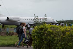 Staff from the United Nations (UN) and International Non-Governmental Organizations (INGOs) depart from Sittwe airport in Myanmar's Rakhine Sate on August 28, 2017. Rohingya Muslims are once more fleeing in droves towards Bangladesh, trying to escape the latest surge in violence in Rakhine state between a shadowy militant group and Myanmar's military. / AFP PHOTO / STRSTR/AFP/Getty Images