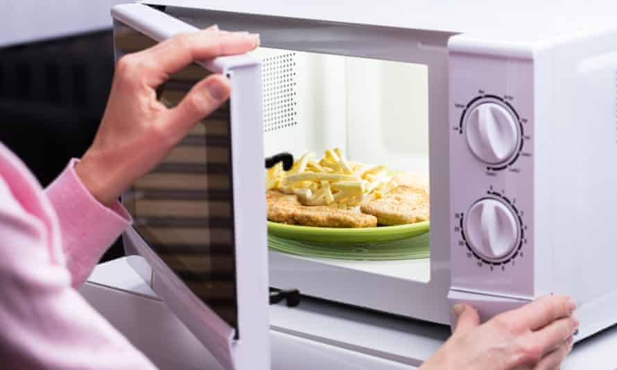 Person opening microwave