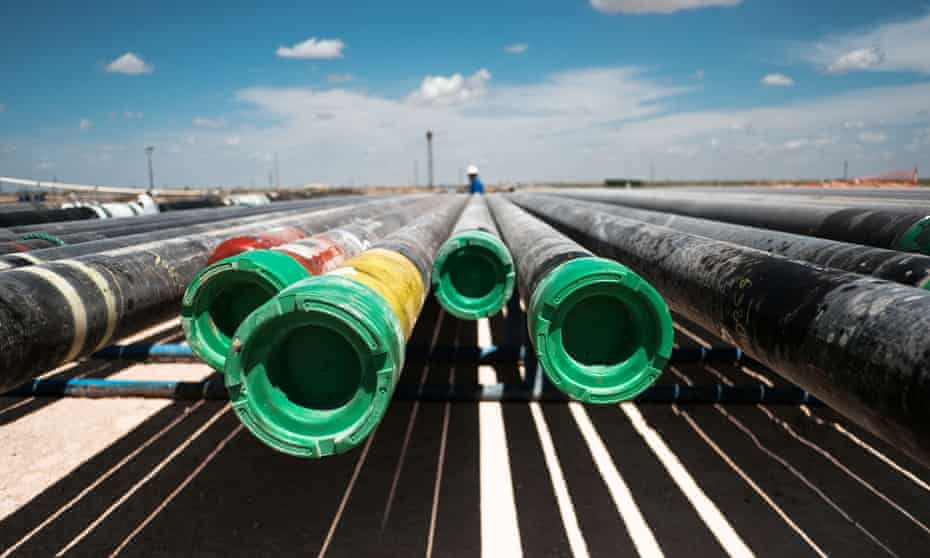 A row of pipes at a Chevron's oil exploration drilling site near Midland, Texas.