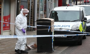 A forensics officer checking a bin in Peel Square in Barnsley town centre after stabbing on Saturday morning.