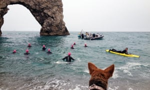 open water swimming at Durdle Door, UK