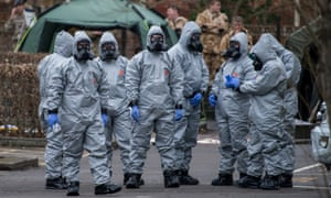Military personnel wearing protective suits conduct investigations in Salisbury.