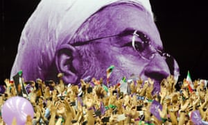 An image of Iran's current president, Hassan Rouhani, at an election rally in Tehran
