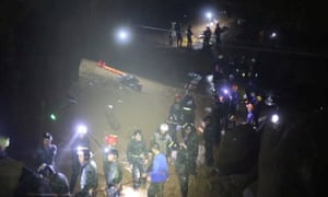 Rescue workers at the Tham Luang cave complex in Chiang Rai.