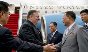 Mike Pompeo (second left) is greeted by the North Korean foreign minister, Ri Yong-ho (second right), during a visit to Pyongyang in July