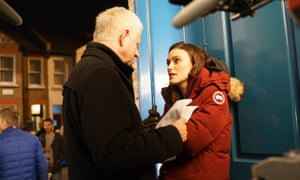 Richard Curtis gives Keira Knightley direction on set.