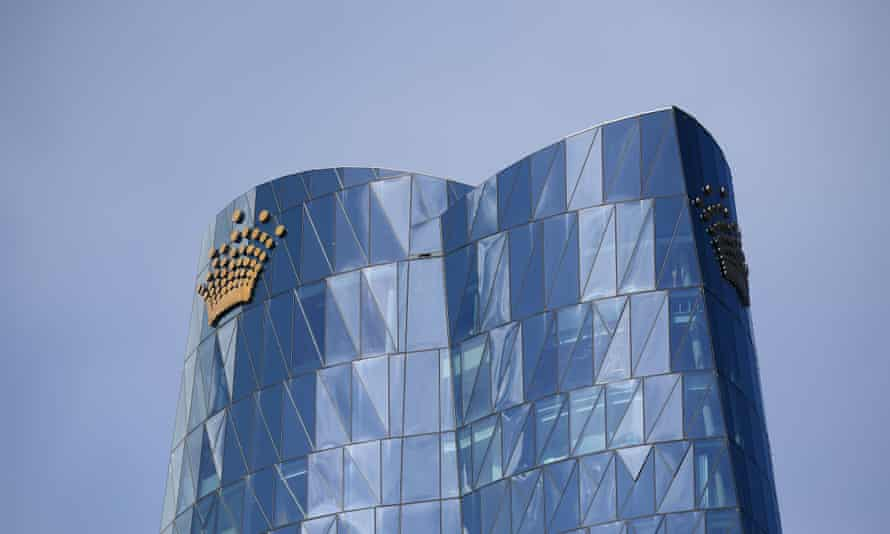 crown's mirrored tower against a blue sky