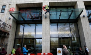 Activists spray tags on the facade of the Shell Centre