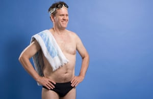 Male swimmer with towel