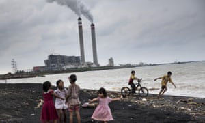 Children play on the beach near a coal power plant in Jepara, Central Java.