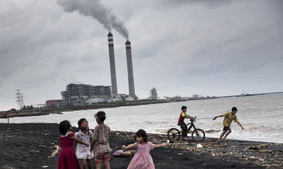 Children play by the beach near a coal power plant in Jepara, Central Java.