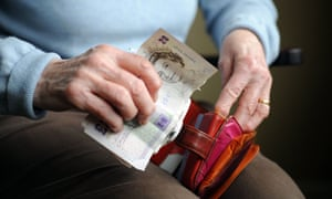 female old aged pensioner  holding money in her arthritic hands