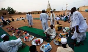 Sudanese men in a suburb of Khartoum prepare to break their fast during Ramadan