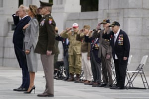 Veterans look on as Donald Trump and first lady Melania Trump participate in a wreath laying ceremony at the World War II Memorial to commemorate the 75th anniversary of Victory in Europe Day.