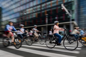 Cyclists enjoy the freedom of a main boulevard during the car-free day in Brussels